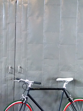 Bike leaning against steel doors