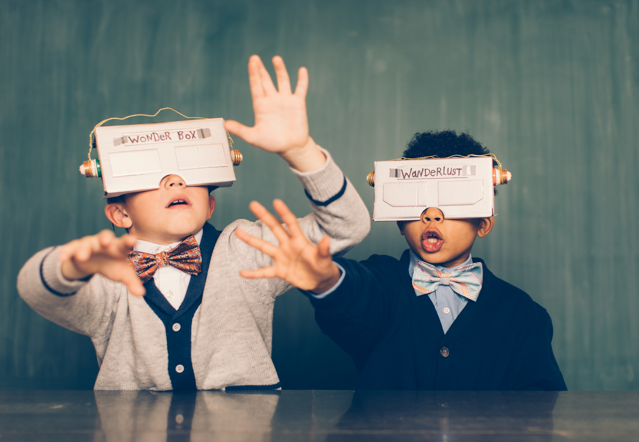 two young kids with homemade AI goggles