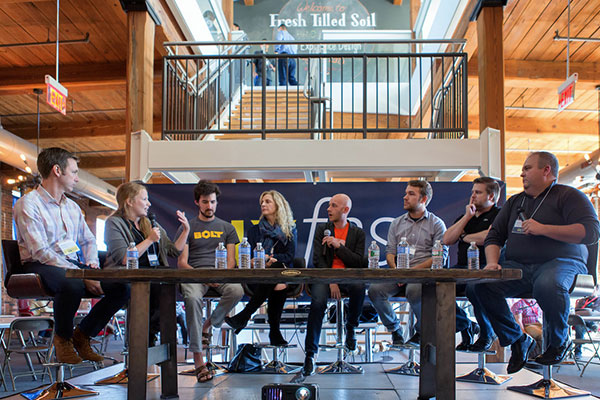 The speakers during a main stage panel discussion on branding and user experience.
