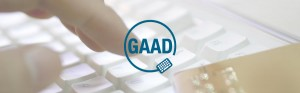 Global Accessibility Awareness Logo (GAAD) with a keyboard and person typing in the background