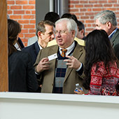 Dr. Al Chase talks with attendees during a break at the Grapevine Event for Connectors.