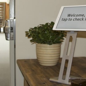 Fresh Tilled Soil entry way with an iPad that says welcome, check in